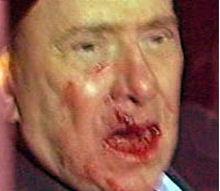 Berlusconi aggredito foto
